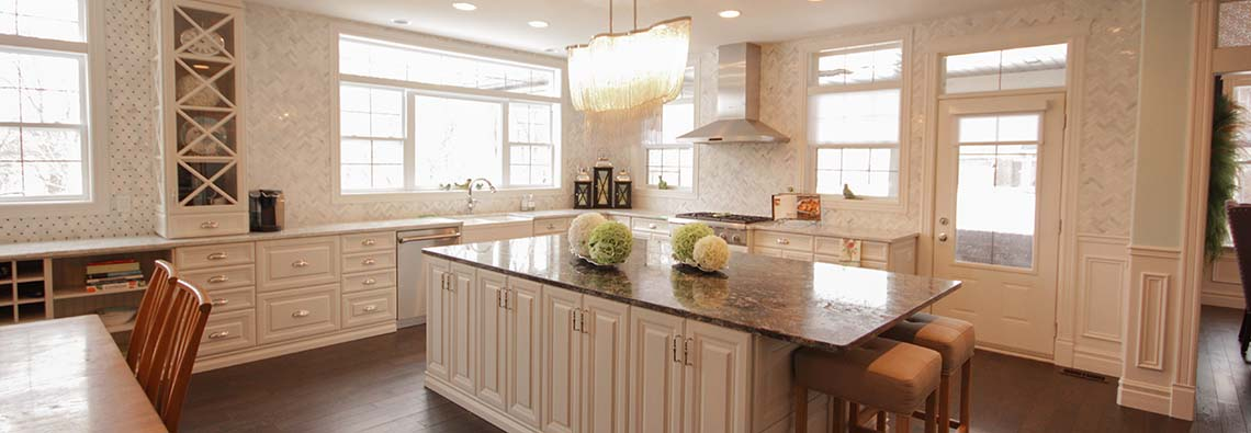 image of kitchen with L shaped counter and center island